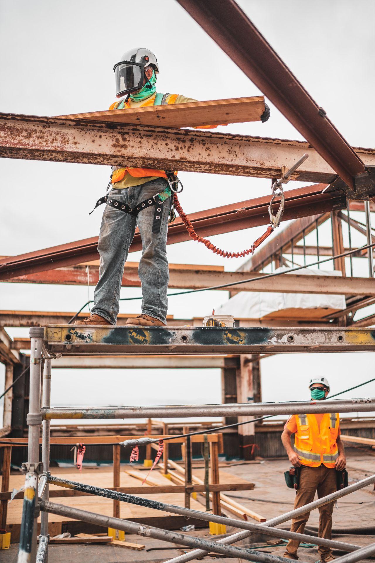 commercial builders Sunshine Coast - builder on scaffholding
