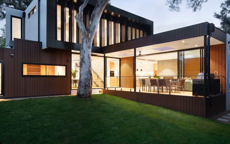 custom builder - modern home exterior at night